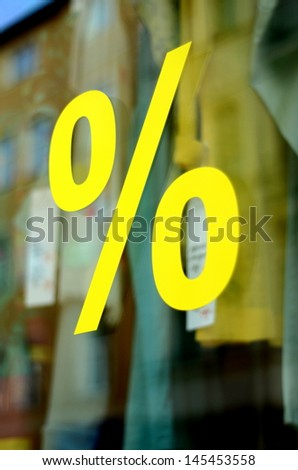 A Large Percentage Sign In A Clothing Store Window (With Shallow DoF) - stock photo