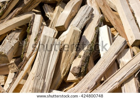 a large pile of dry Firewood - stock photo