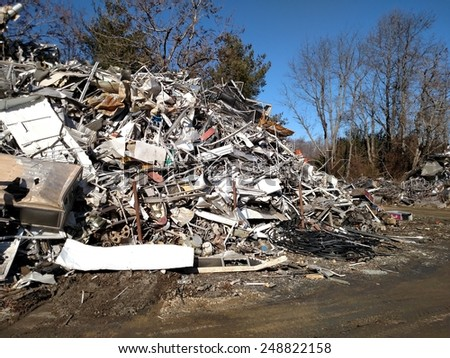 A large pile of scrap metal piled up outside