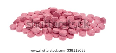 A large portion of vitamin B12 tablets isolated on a white background.