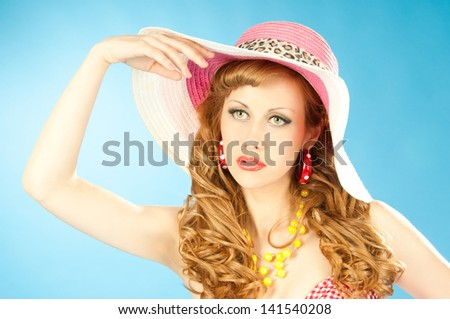 A large portrait of a cute red-haired girl in the pink sun hat - stock photo