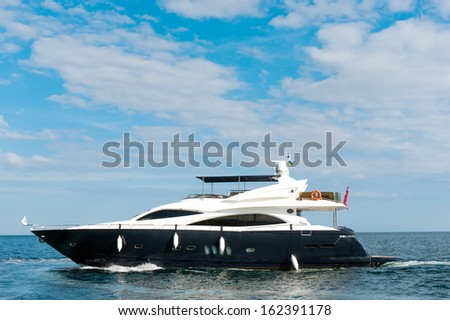 A large private motor yacht under way out at sea - stock photo
