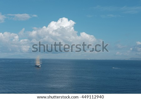 A large sailing ship enters the harbor. Italy. - stock photo