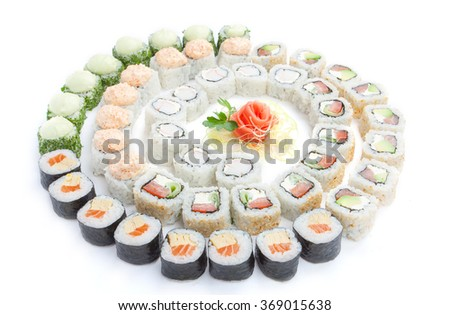 a large set of sushi on a white background - stock photo