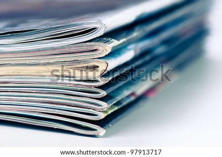 A large stack of magazines piled high.