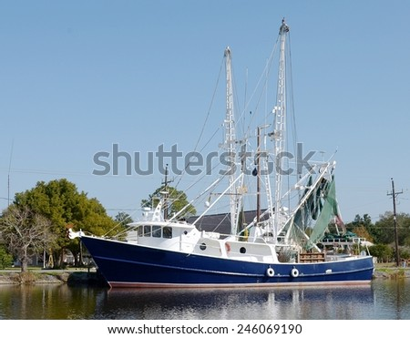 A large steel shrimp trawler boat at dock in Bayou Lafourche in South Louisiana. - stock photo