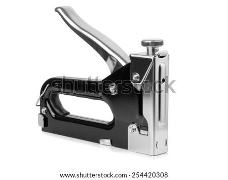 A large tacker stapler gun on a white background - stock photo