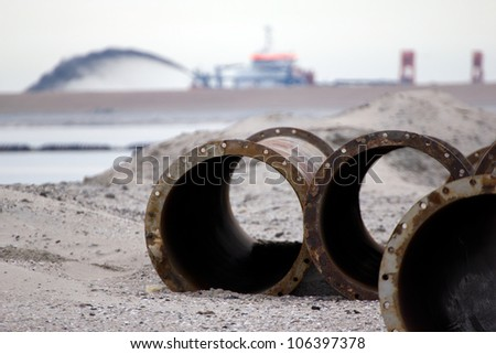A large trailing suction hopper dredging creating new land along the Dutch shore - stock photo