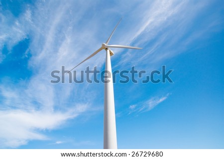 A large turbine spins in a wind farm