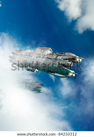 A large ufo or spaceship is seen flying through a bright blue, cloud covered sky. - stock photo