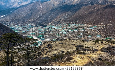 A large village of the valley of sherpas - Khumjung, Nepal, Himalayas - stock photo