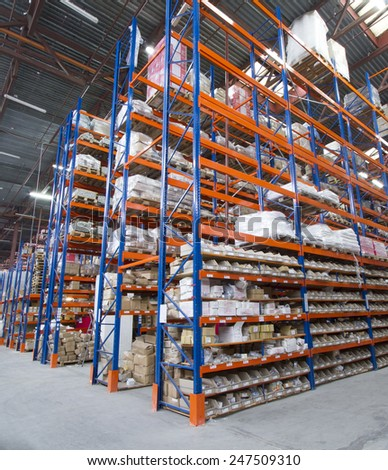A large warehouse. Pallet metal racks with a heavy load. - stock photo