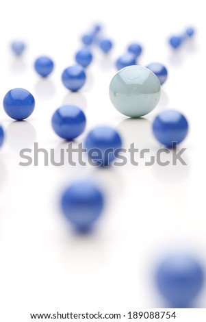 A large white ball surrounded by blue balls