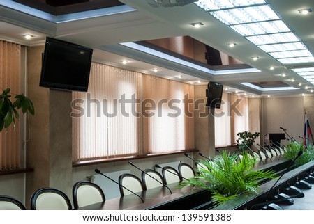 A large windows, table and chairs in a modern conference room. - stock photo