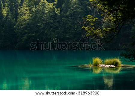 A late afternoon scene at one of the Laghi di Fusine in Northern Italy - stock photo