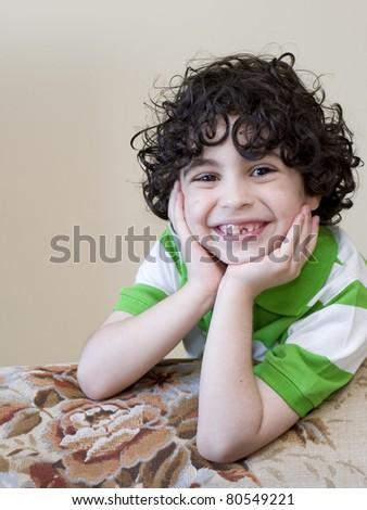 A Latino Boy's portrait taken at home - stock photo