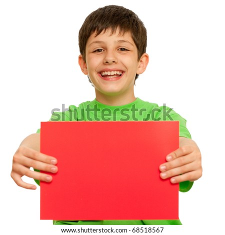 A laughing boy is holding a sheet of red paper; isolated on the white background - stock photo