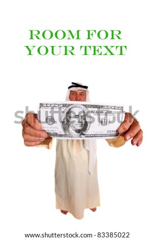 A laughing man wearing an Arabic headdress, keffiyeh and agal holds a Giant $100.00 dollar bill to the camera, isolated on white with room for your text. Focus on the money in his hand. - stock photo