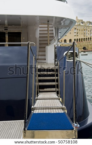 A launch with it's gangplank down. - stock photo