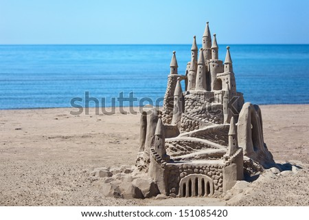 A lavish and large sand castle on an empty beach. - stock photo