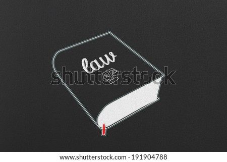 A Law Book on a Black Chalkboard - stock photo