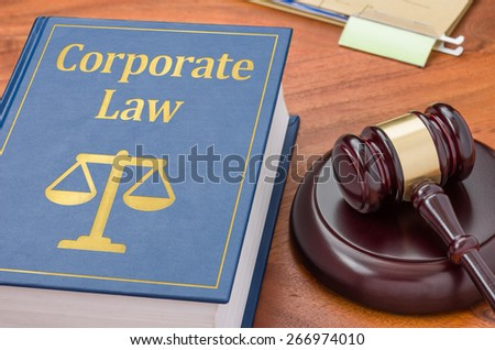 A law book with a gavel - Corporate law - stock photo