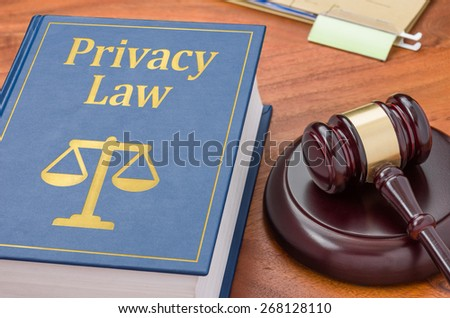 A law book with a gavel - Privacy law - stock photo