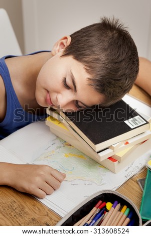 a lazy boy sleeping on the books - stock photo