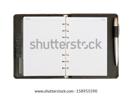 a leather notebook with spiral, pen and blank lined paper - stock photo