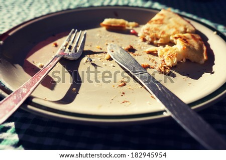 A left over pancake after breakfast eating in Leh,Ladakh in vintage filter  - stock photo