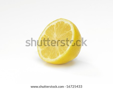 A Lemon sliced in half on a clean white background