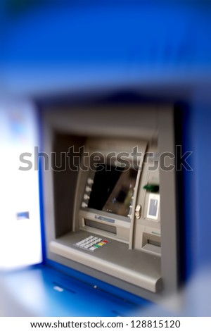 A lens blurred photo of an ATM - stock photo