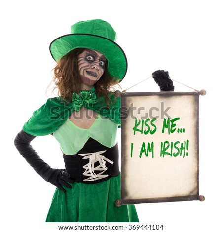 a Leprechaun girl holding a scroll with text Kiss me i am irish, isolated on white - stock photo