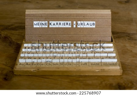 "a letterbox with the german text: ""Meine Karriere=Urlaub"" (my career = vacation)"