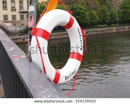A life buoy of Berliner Feuerwehr meaning Berlin Fire Department on river Sprea in Berlin