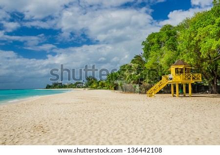 A Lifeguard Hut on a Deserted Sand Beach in Barbados - stock photo