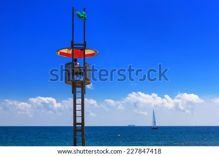 a lifeguard tower on the beach - stock photo