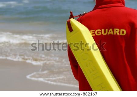 A lifeguard watching along a sandy beach - stock photo