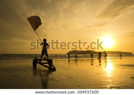 A lifeguard waving a red flag at Cenang beach, Langkawi - stock photo