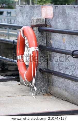 A lifesaver mounted near a danger zone of a river.
