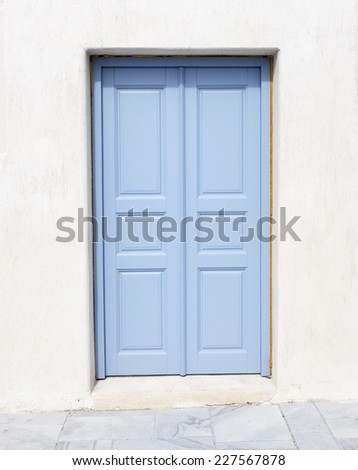 A light blue front door without handle. - stock photo