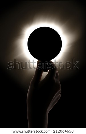 A light bulb obscured by solar. it means solar-powered light bulb for our earth.  - stock photo