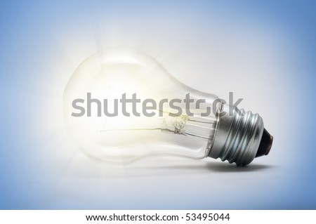 a light bulb on the blue background - stock photo