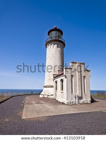 A light house in cape disappointment state park - stock photo