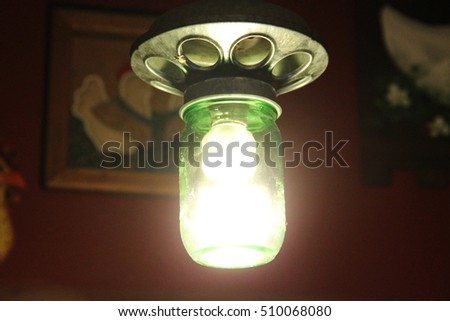 A light made from mason jar and chicken feeder. Recycled Americana