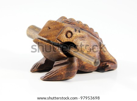 a light wooden frog figurine, isolated on a white background - stock photo