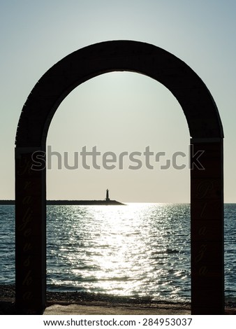A lighthouse in an arch