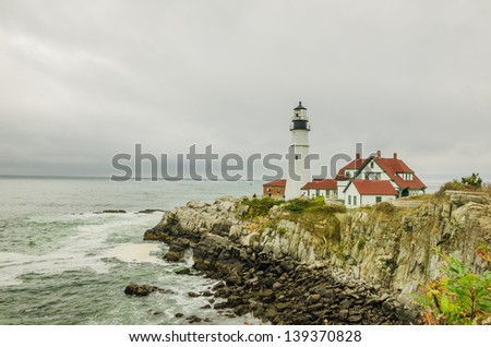 A Lighthouse on a Cloudy Day - stock photo