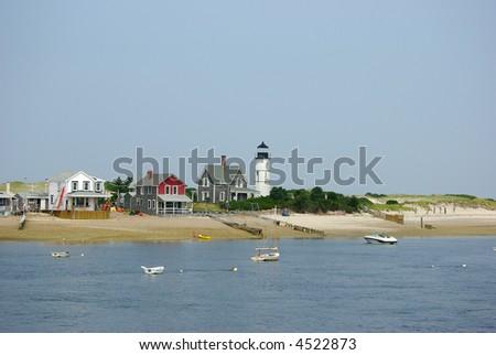 A lighthouse on Cape Cod bay near Barnstable, Massachusetts - stock photo