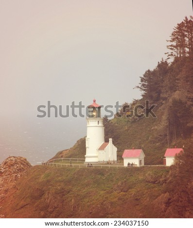 a lighthouse on the cliffs toned with a soft retro vintage instagram filter effect - stock photo